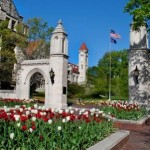 WEB 20120409-0172-IU clocktower and gates with tulips low res   by hand
